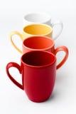 Tasses colorées lumineuses Image stock