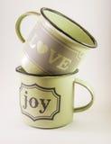 Tasses complètement d'amour et de joie Image stock