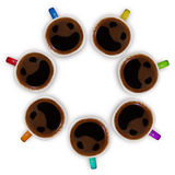 Tasses de café avec les visages souriants Image stock