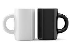 Tasses de café blanc et noir Photographie stock libre de droits