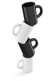 Tasses de café blanc et noir Photo libre de droits