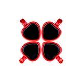 Tasses de café en forme de coeur rouges comme trèfle Photo stock