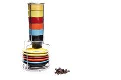 Tasses de café express et grains de café Photographie stock libre de droits