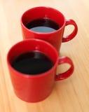 Tasses de café rouges Photographie stock libre de droits