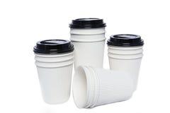 Tasses de carton pour les boissons chaudes et de froid Photos stock