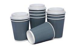 Tasses de carton pour les boissons chaudes et de froid Image libre de droits