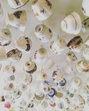 Tasses de thé accrochantes Image libre de droits