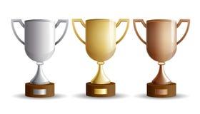 Tasses de trophée réglées Images stock
