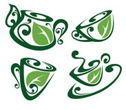 Tasses et pots de thé complètement de boissons organiques Photographie stock libre de droits