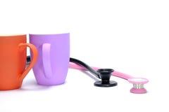 tasses et stéthoscopes de coffe Photos libres de droits