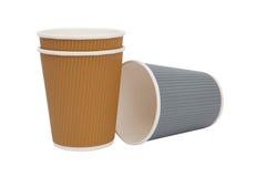 Tasses multicolores de carton pour les boissons chaudes Photos stock