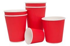 Tasses rouges de carton pour les boissons chaudes Photographie stock