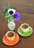 Tasses vertes et oranges Photographie stock
