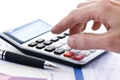 Tassi il calcolatore e la penna Fotografie Stock Libere da Diritti