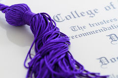 Tassle and diploma Stock Photos
