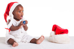 Taste the blue. A tiny African baby girl are ready for her first Christmas to arrive Royalty Free Stock Photos