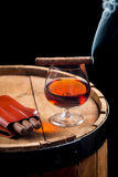 Taste of burnt cigar and cognac Stock Photography