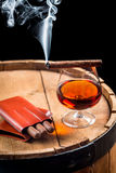 Taste of burnt cigar and cognac Royalty Free Stock Photos