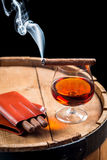 Taste of burnt cigar and cognac Stock Photo