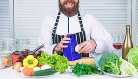 Taste it. Chef man in hat. Secret taste recipe. Vegetarian. Mature chef with beard. Bearded man cook in kitchen royalty free stock photos