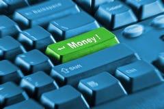 Taste des grünen Geldes auf einer blauen Tastatur Stockfotos
