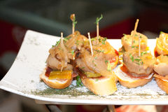 Taste the flavour variety of plates. Different small plates for catering and tasting at bars Stock Images