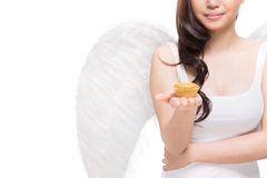 Taste of heaven. Angel sharing a taste of heaven by giving a small cake Royalty Free Stock Photos