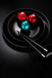 The taste of New Year. Creative photo of black plate in a japanese sushi restaurant menu decorated with Christmas balls and chopsticks stock photos