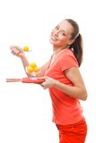 Taste ping-pong as this woman does Stock Photography
