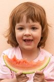 Taste of summer. Little cute girl eating water melon Stock Photography