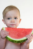 Taste of Summer. Image of cute toddler eating a big piece of watermelon Royalty Free Stock Photos