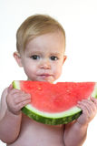 Taste of Summer. Image of cute toddler eating a big piece of watermelon Royalty Free Stock Image