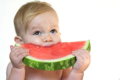 Taste of Summer. Image of cute toddler eating a big piece of watermelon Stock Photo