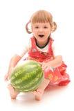Taste of summer. Little cute girl eating water melon Stock Photos
