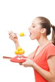Taste table tennis sport. Concept - woman with racket and orange balls Stock Image