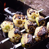 Taste vegetables. Taste grilled vegetables, barbeque. For vegetarians Royalty Free Stock Image