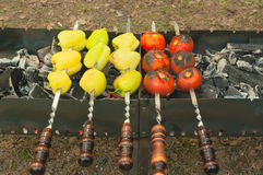 Taste vegetables. Taste perfectly fried vegetables on the coals Stock Photos