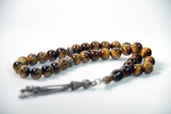 A beautiful bright rosary, using a Muslim man stock photography