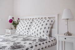 Tasteful bed linen. Beautiful and tasteful bed linen in a bedroom Royalty Free Stock Image