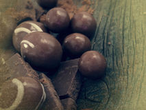 Tasteful chocolate. On the wooden table Royalty Free Stock Photos