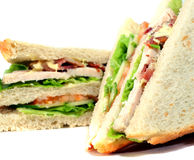 Tasteful club sandwich. With bacon, ham, turkey, lettuce, and tomato Royalty Free Stock Photography