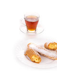 Tasteful Eclair with tea Royalty Free Stock Photo