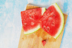 Tasteful fresh watermelon fruit slices on the table. Top view Stock Photo
