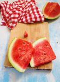 Tasteful fresh watermelon fruit slices on the table. Top view Stock Images