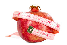 Tasteful fruit garnet with measuring tape Stock Image