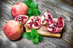 Tasteful, juicy tropical fruit pomegranate Stock Images