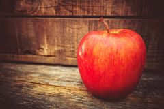 Tasteful Red Apple. Fresh Tasteful Red Apple on the Wooden Table. Apple Fruit Stock Images