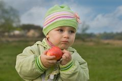 Tastelessly. Children do not love sour apples Royalty Free Stock Photos