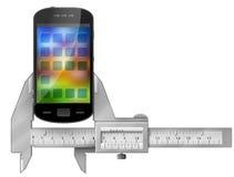 Tasterzirkel misst Smartphone Lizenzfreies Stockfoto