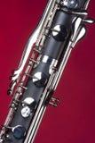 Tasti del Clarinet basso su colore rosso Fotografia Stock Libera da Diritti